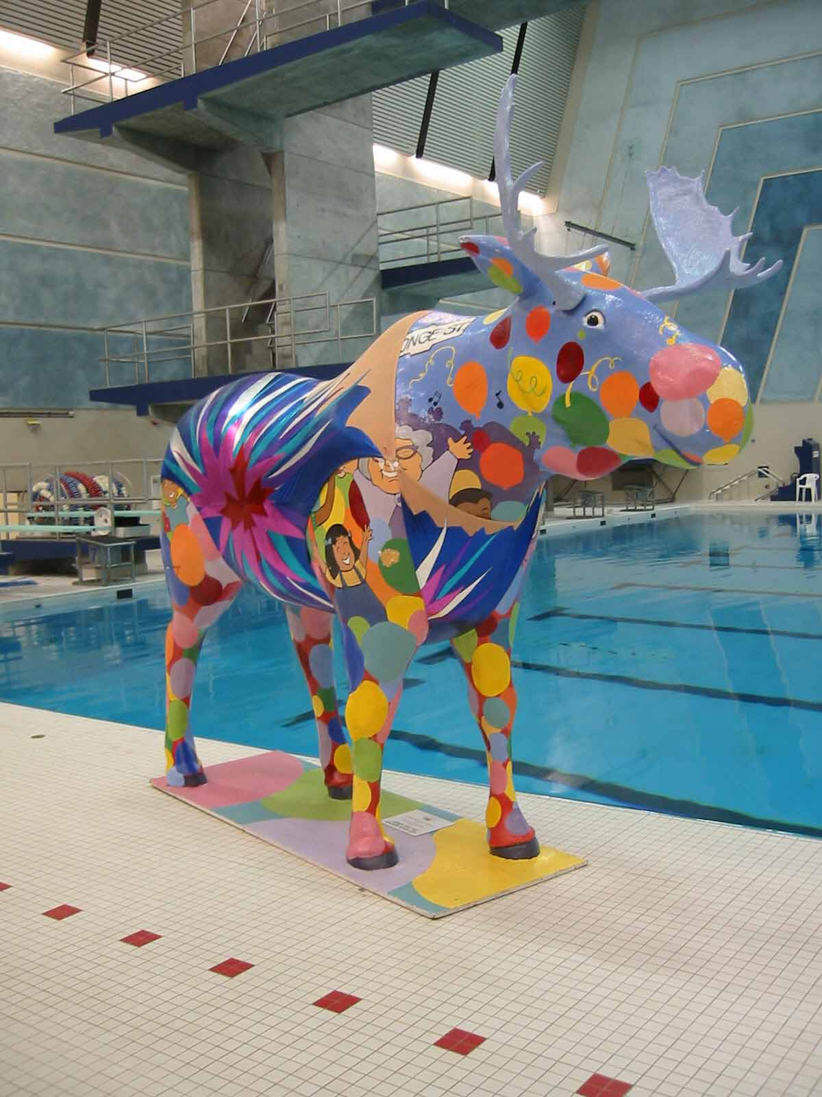 A very large, very colourful fiberglass moose models a custom synchro swimsuit.