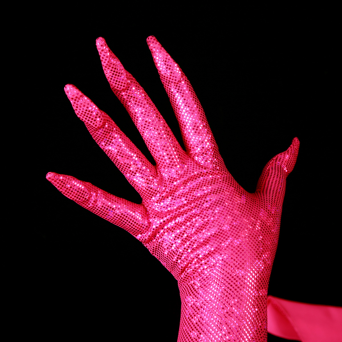 A hand is shown wearing a sparkly hot pink glove, with built in claws.