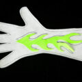 A glove pattern has been cut out of exam table paper. A neon green flame has been cut from fabric and placed on top.