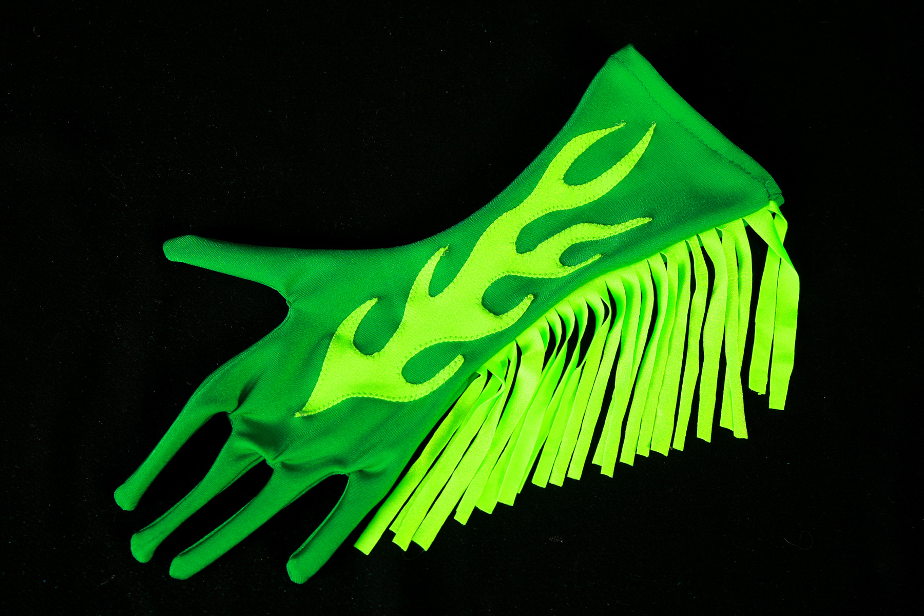 A dark green glove with bright green finge up one side, and a bright green appliqued flame design up the middle.