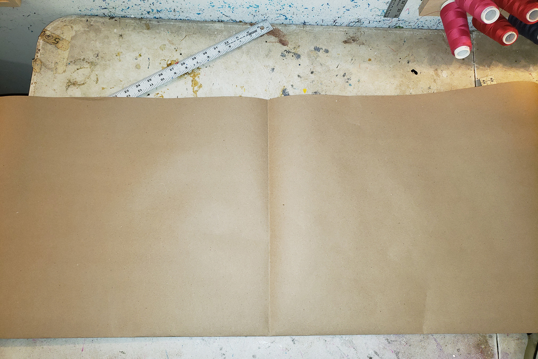 A large, folded piece of brown craft paper.