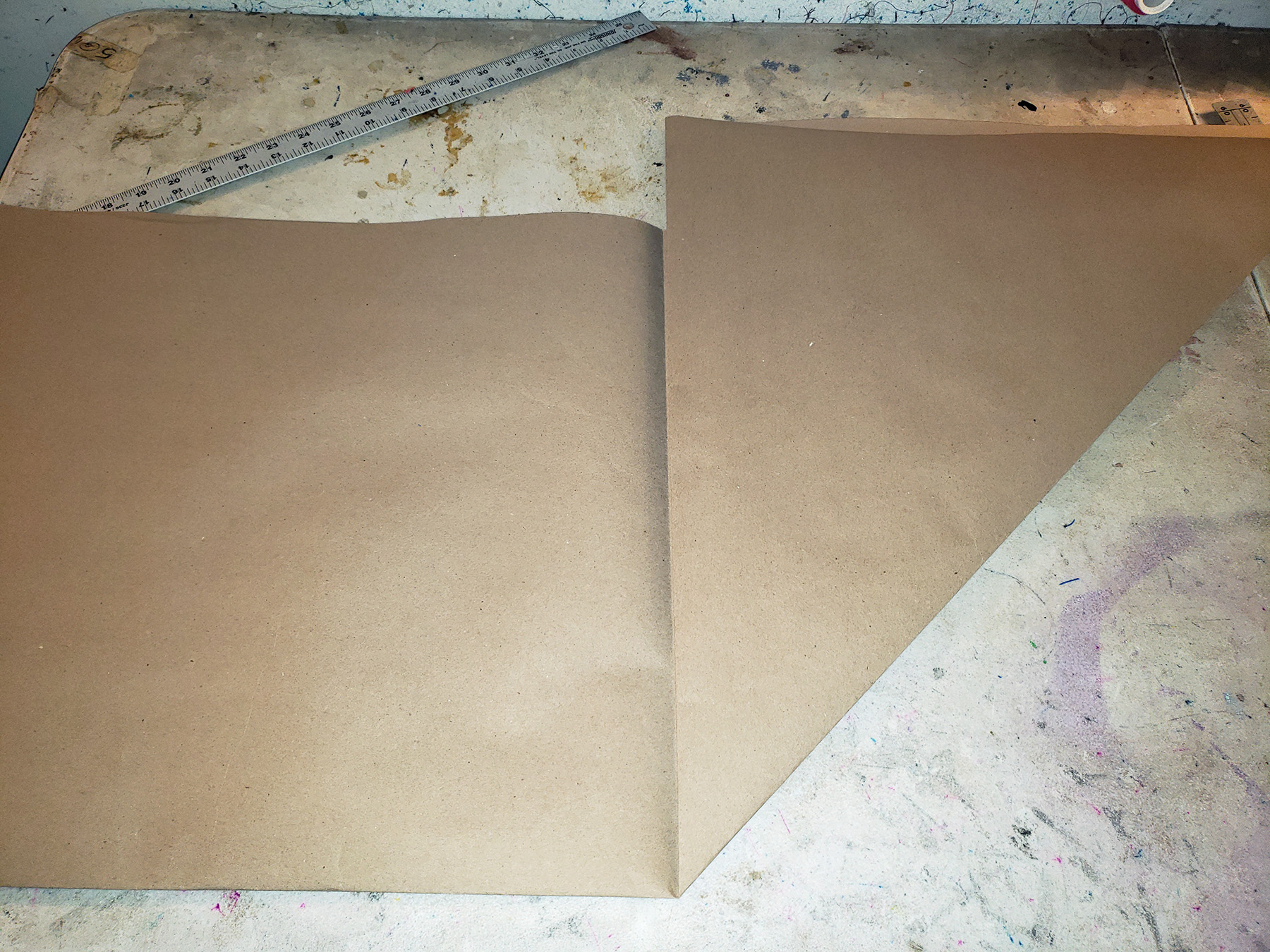 A brown piece of craft paper is folded up on itself.