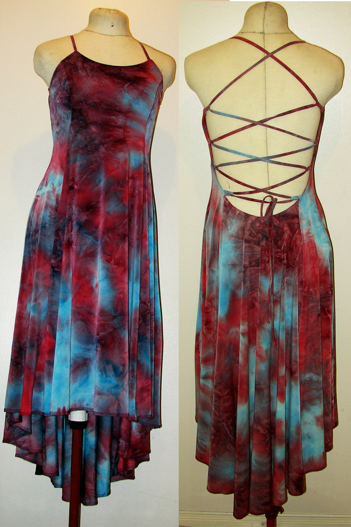 A long red and blue tie dyed dress is displayed on a beige dress form.