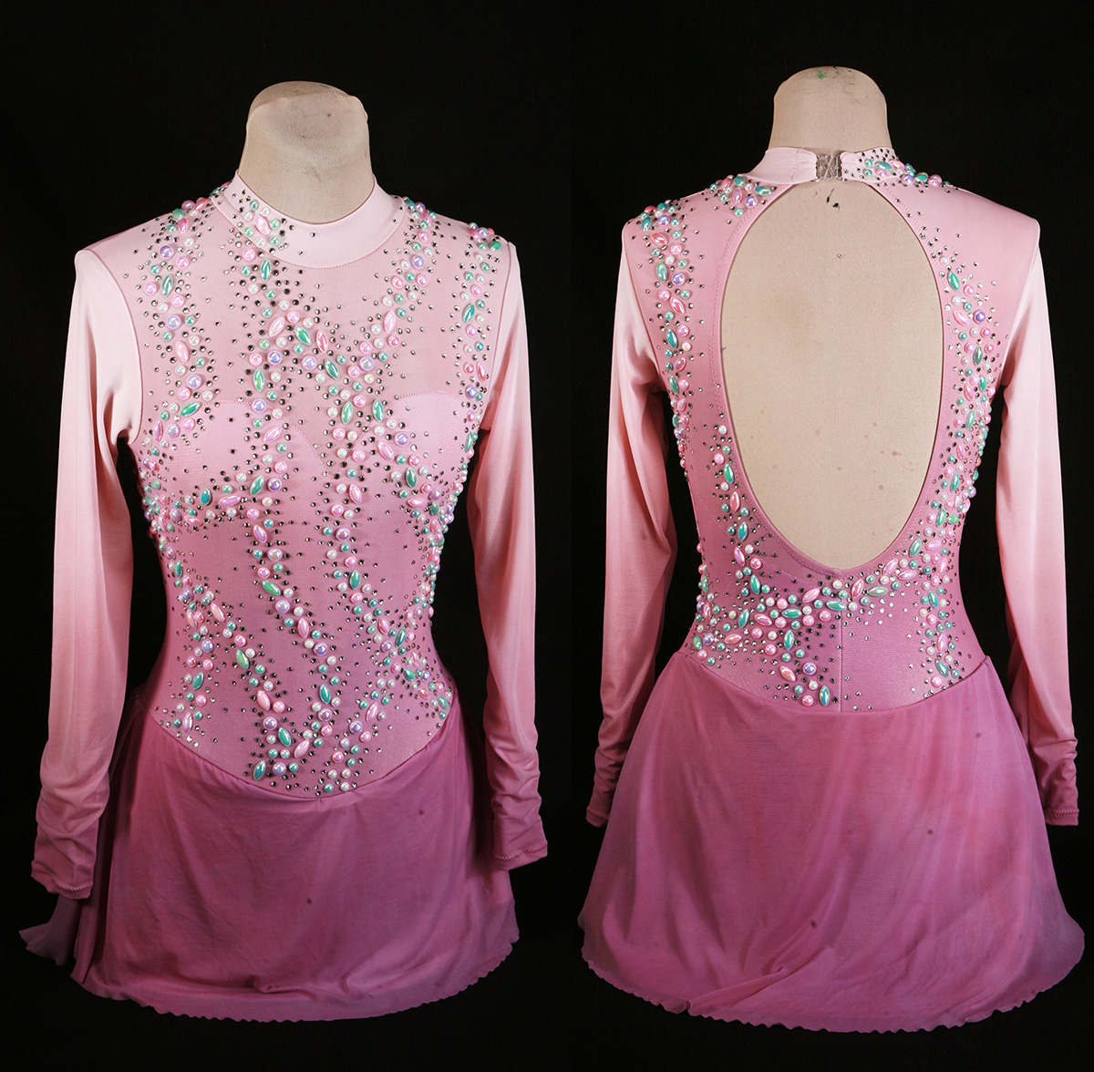 The front and back views of a pink and purple skating dress, heavily embellished with pearls and crystals.