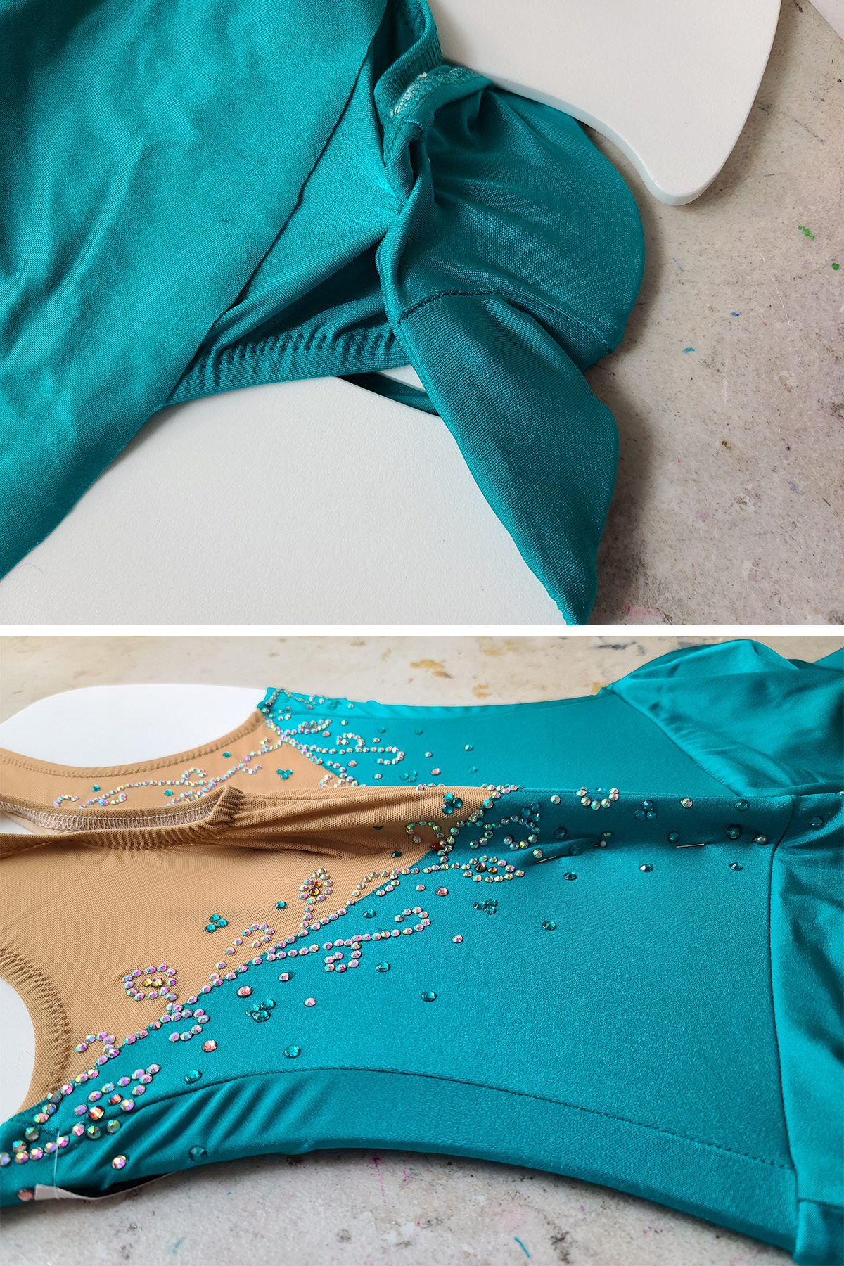 A light teal skating dress is on a stretcher board. These two images show it pinned back at both the crotch, and up the back of the dress.