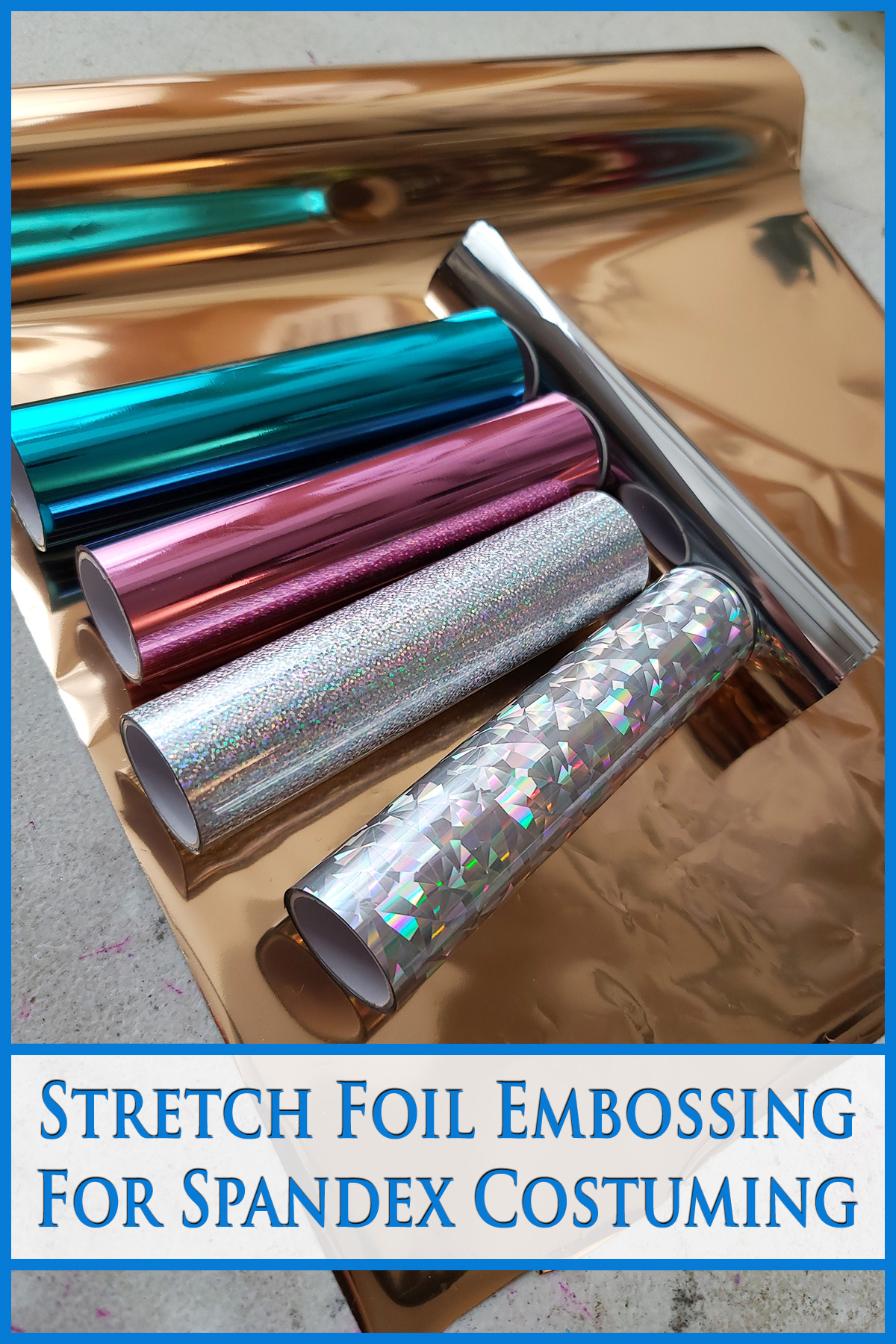 5 rolls of various colours of foil transfer paper laid out on a sheet of copper coloured foil. Blue text says Stretch Foil Embossing for Spandex Costuming.