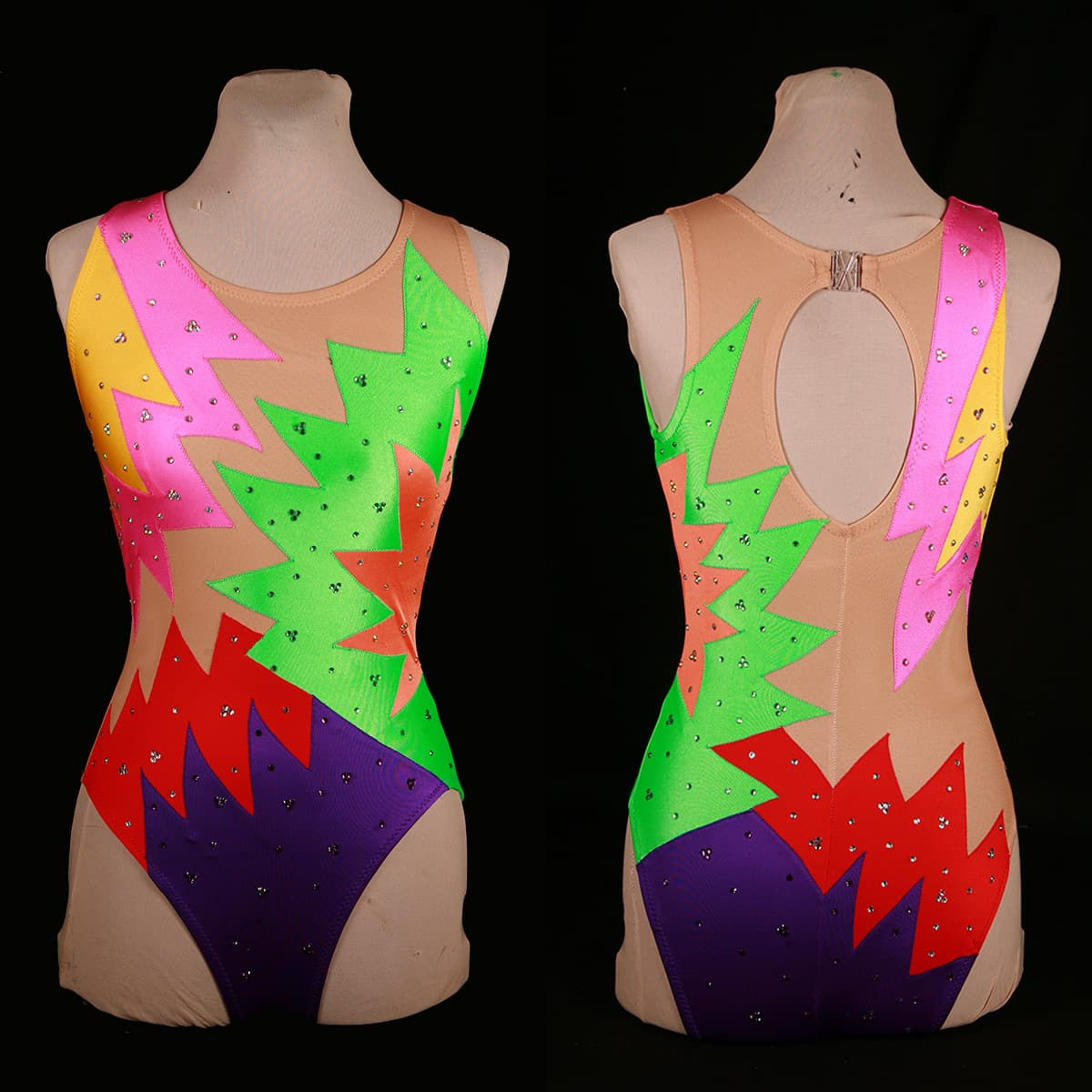 A front and back view of the finished synchro suits, on a dress form.