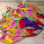 A pile of completed jazz team synchro suits is shown.