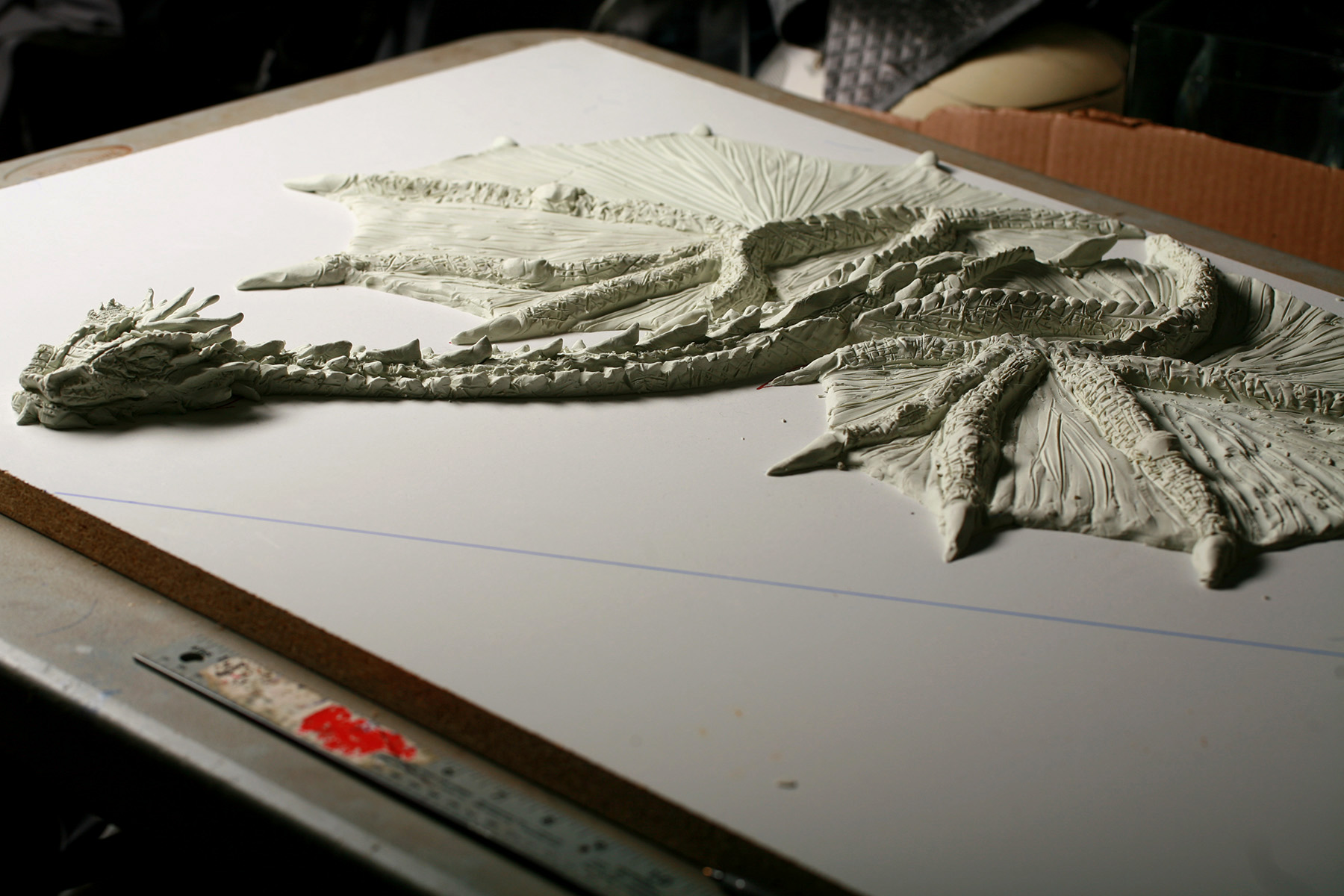 A full view of the clay sculpted Smaug dragon's full body.
