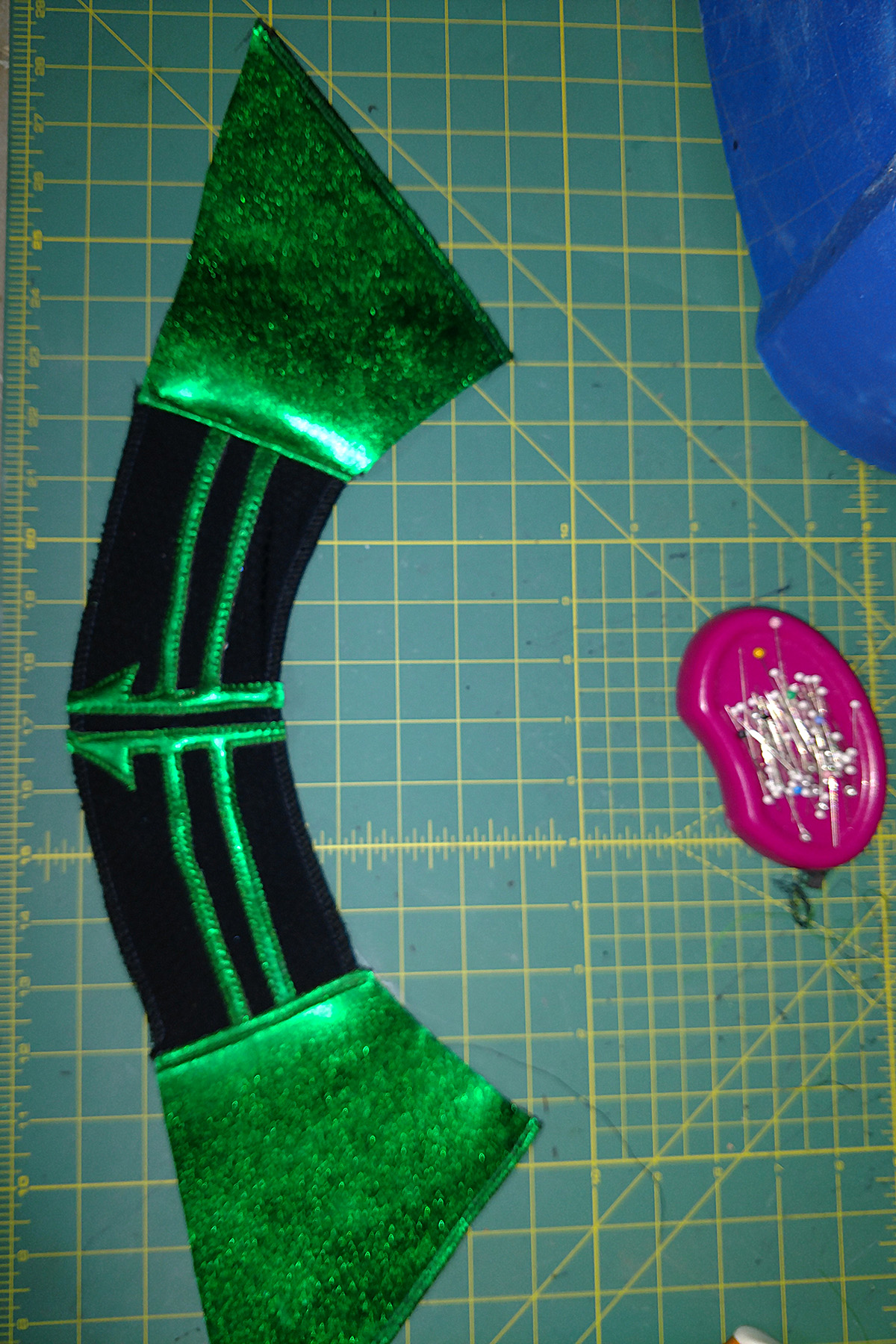 An intricately sewn green and black collar piece for a Hela costume.