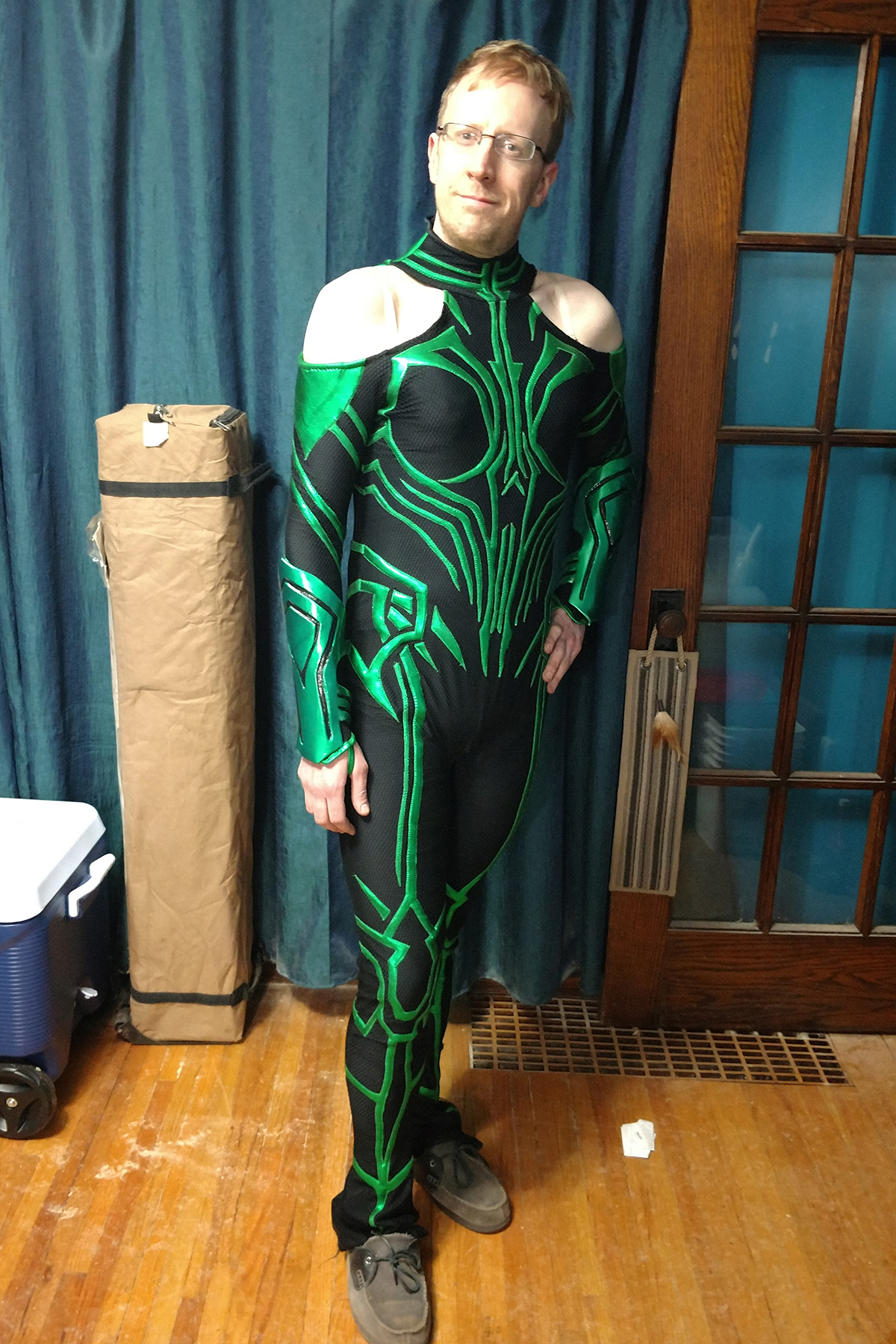 A front view of a blonde man wearing an MCU Hela costume.