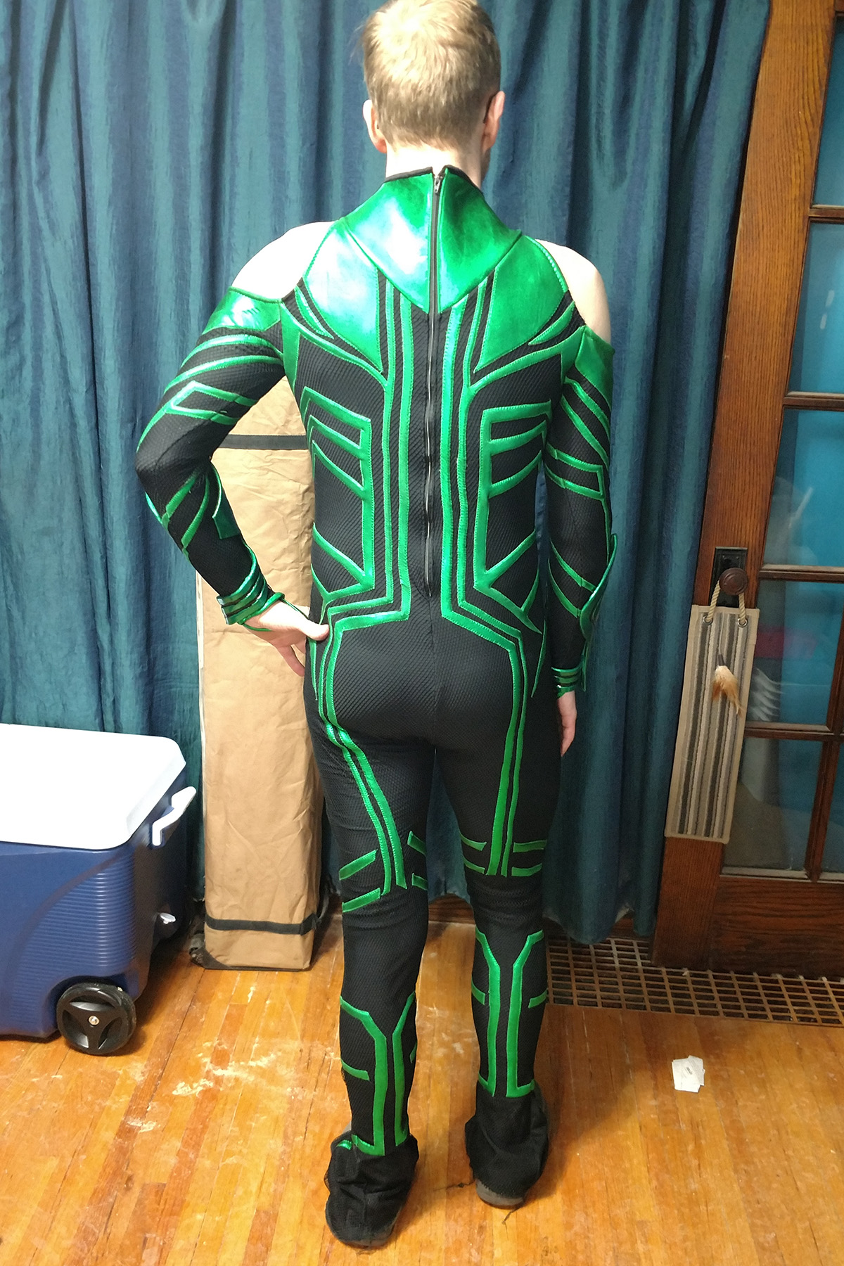 A back view of a blonde man wearing an MCU Hela costume.