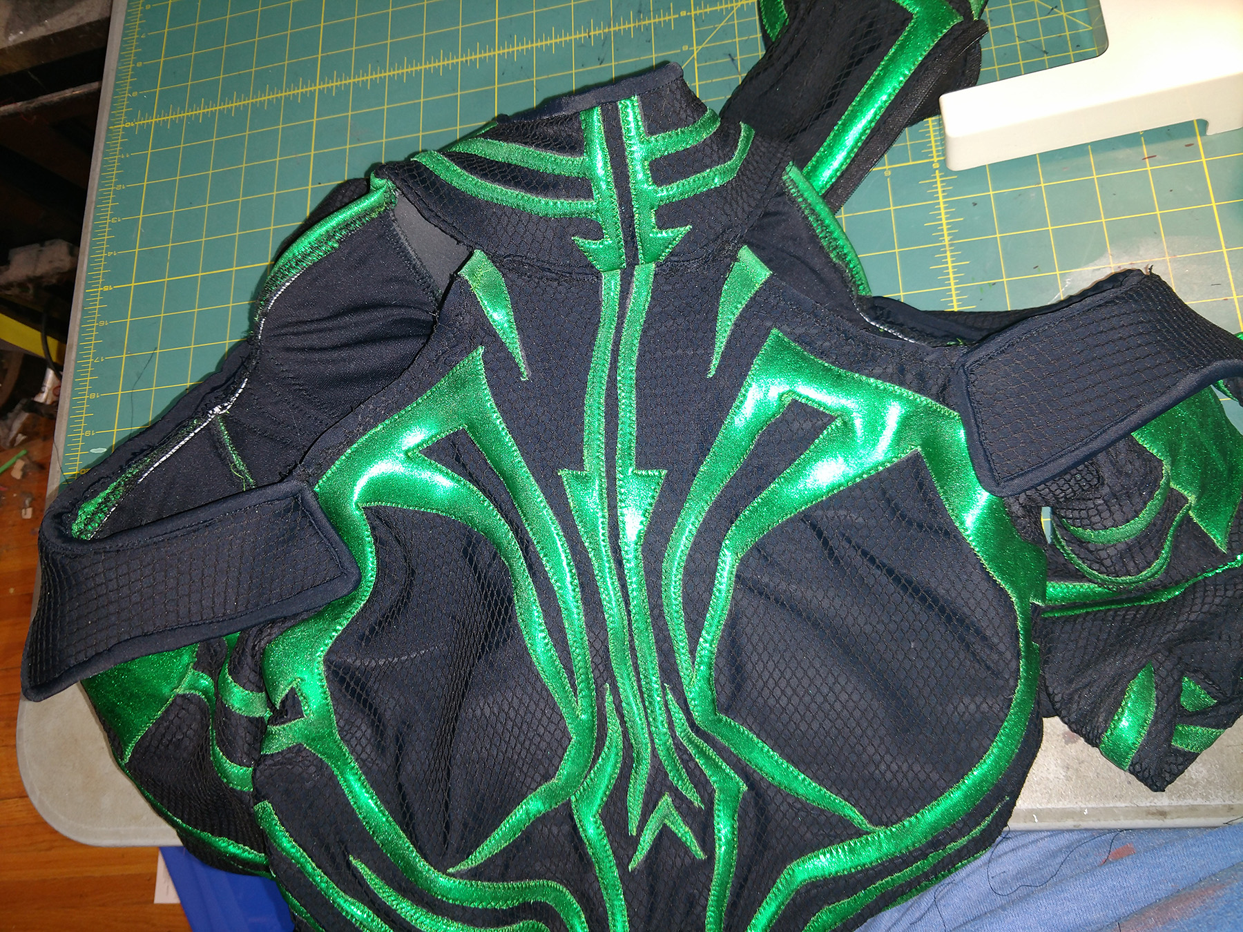The Hela cosplay, folded up on a work surface, giving a close up view of the collar and shoulder area.