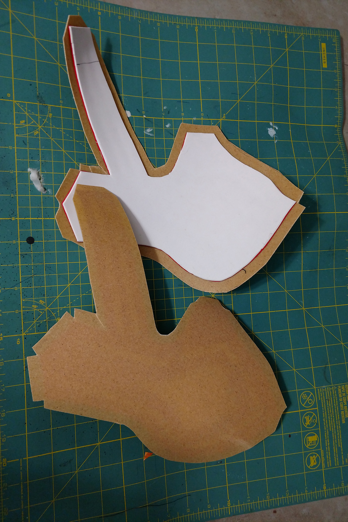 Front and back views of the craft foam bracers, with a layer of tan coloured Worbla attached to the front of each,