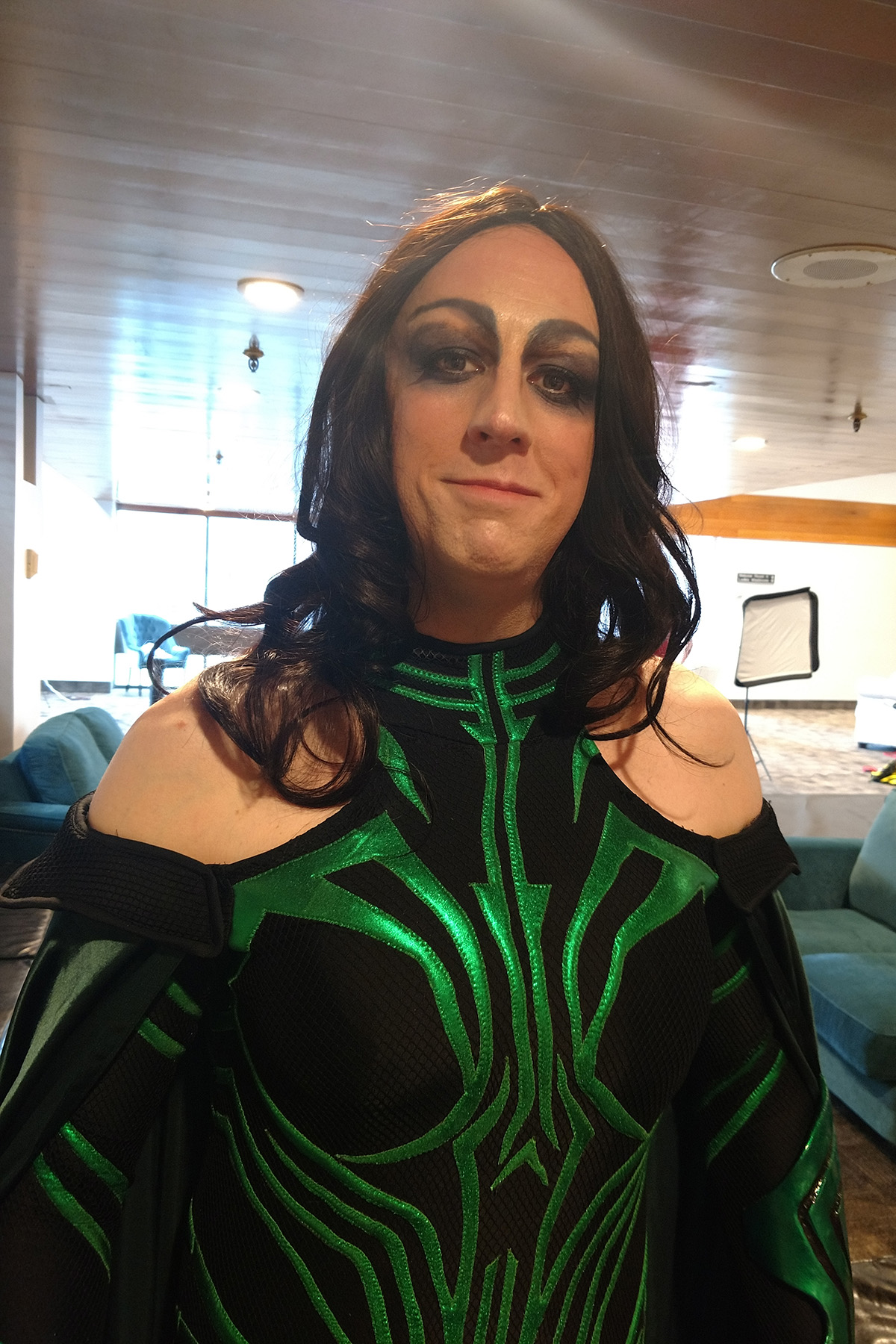 A dude in full Hela costume, hair, and makeup.