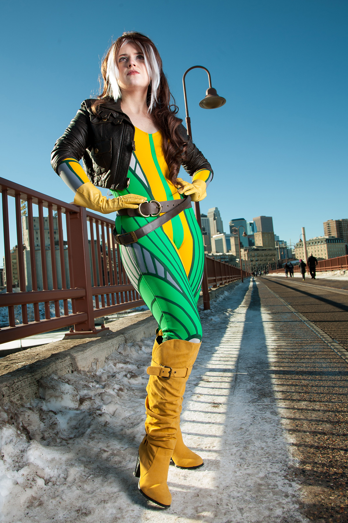 A gorgeous cosplayer dressed as a stylized version of X-Men's Rogue.