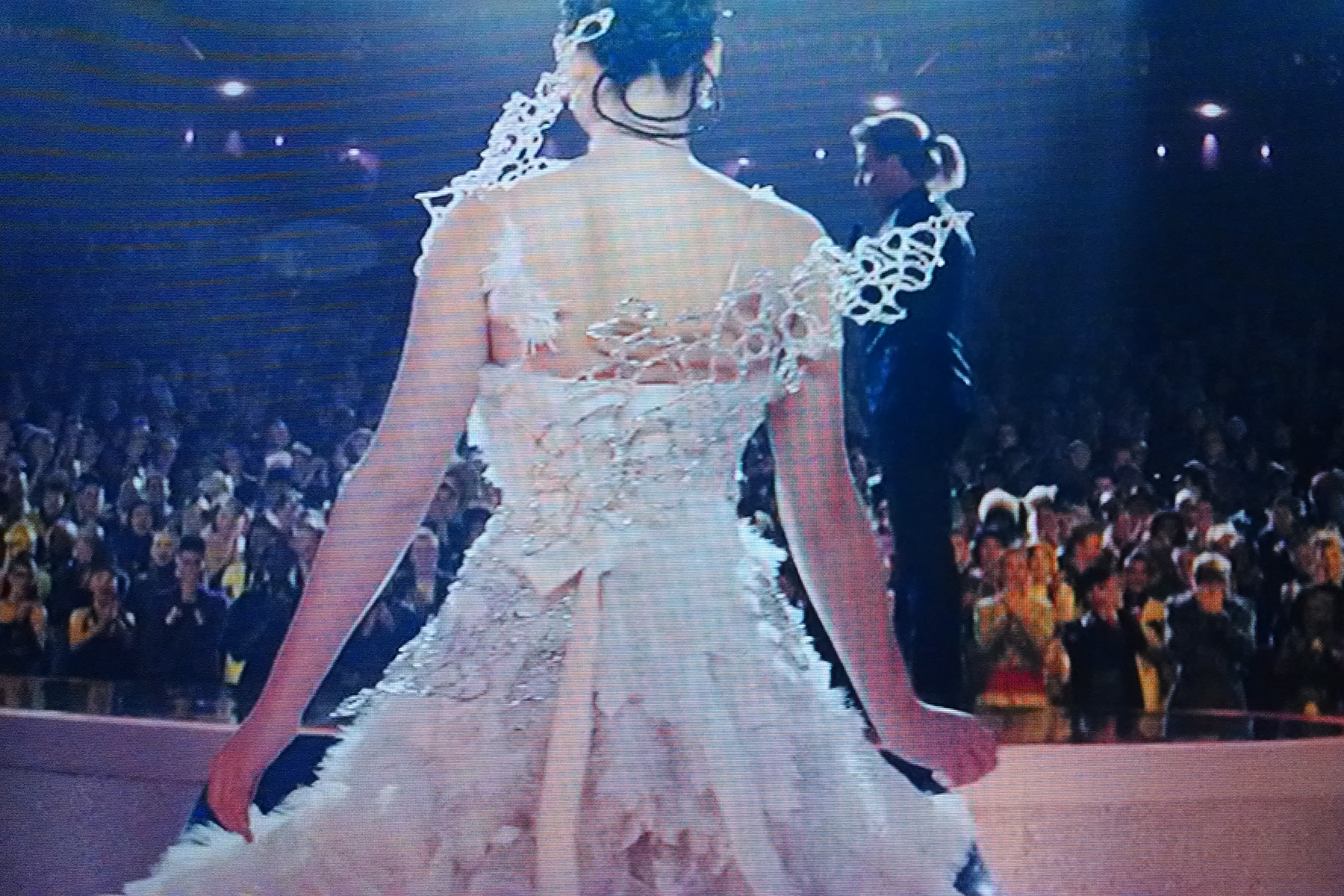A screen shot from Hunger Games: Catching Fire. Back view of Katniss in her wedding gown.
