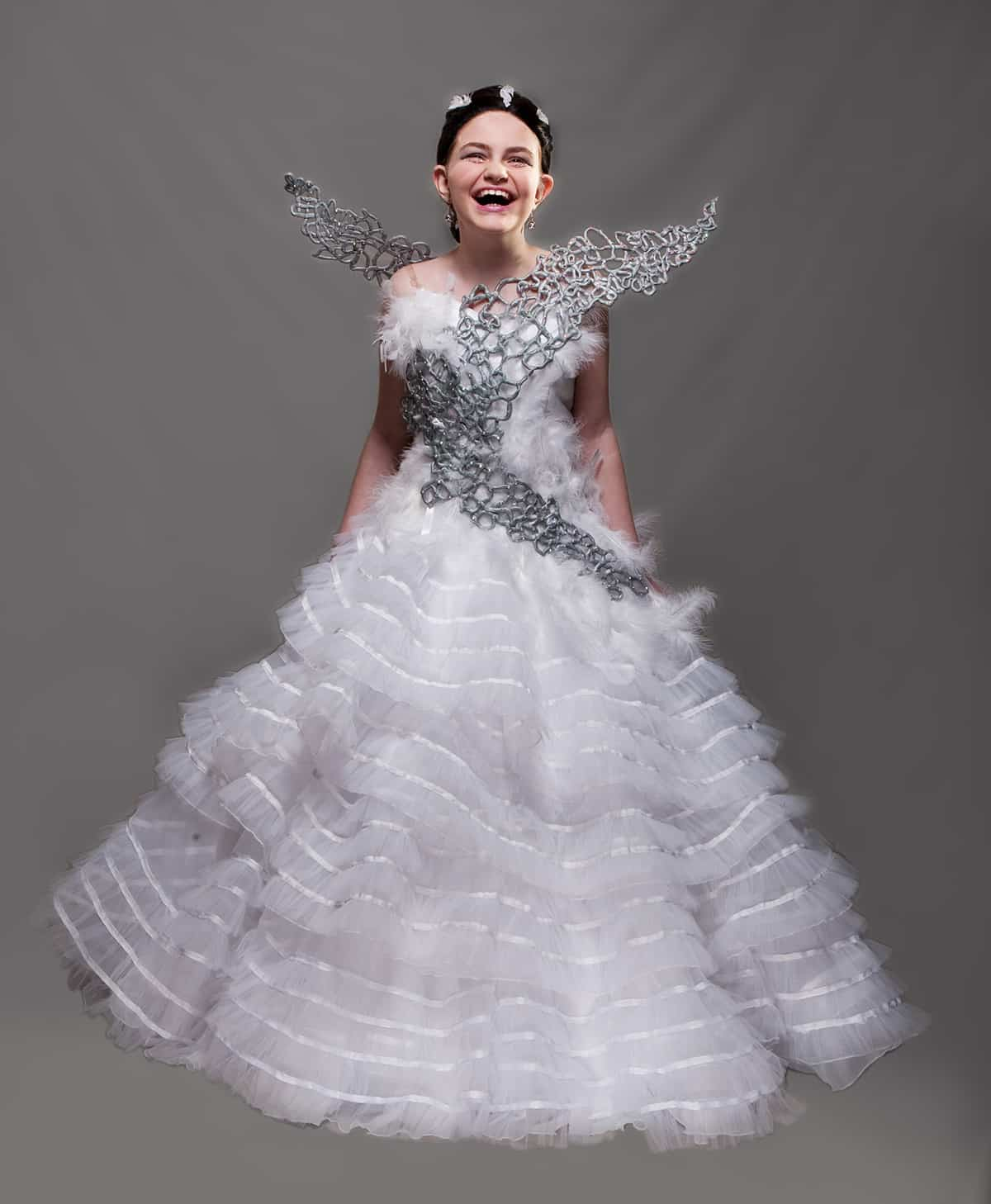 A beautiful young woman wearing a replica of the Katniss Wedding Gown from Hunger Games.