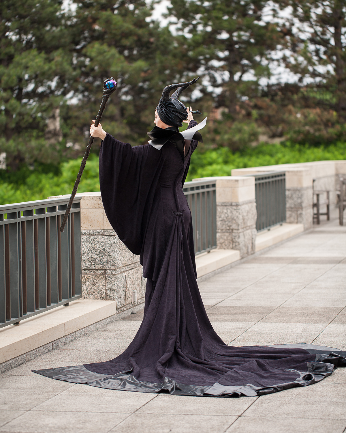 A cosplayer dressed in the full Maleficent costume.