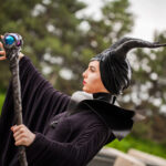 A close up view of a cosplayer dressed as Maleficent.