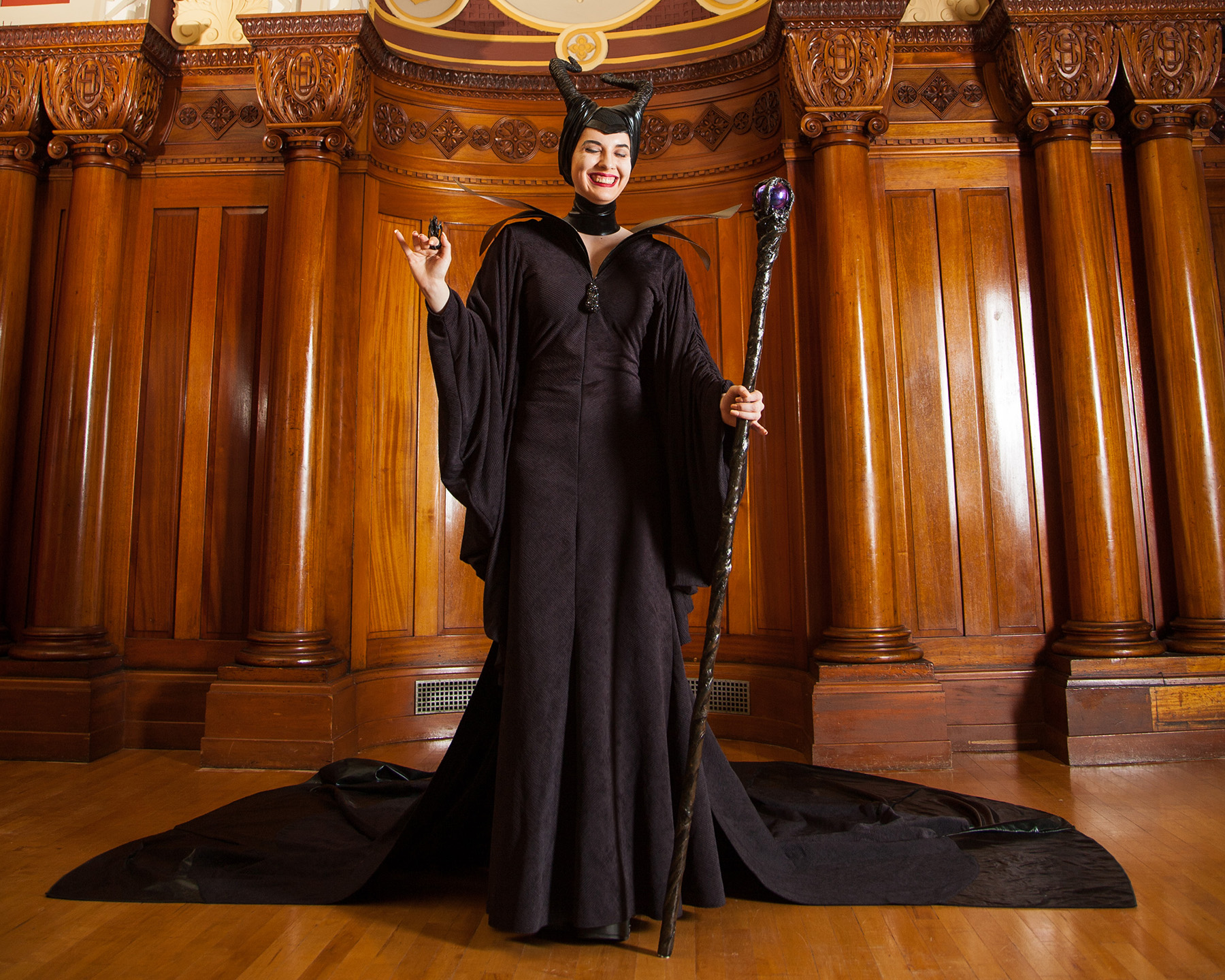 A cosplayer dressed in the full Maleficent cosplay.