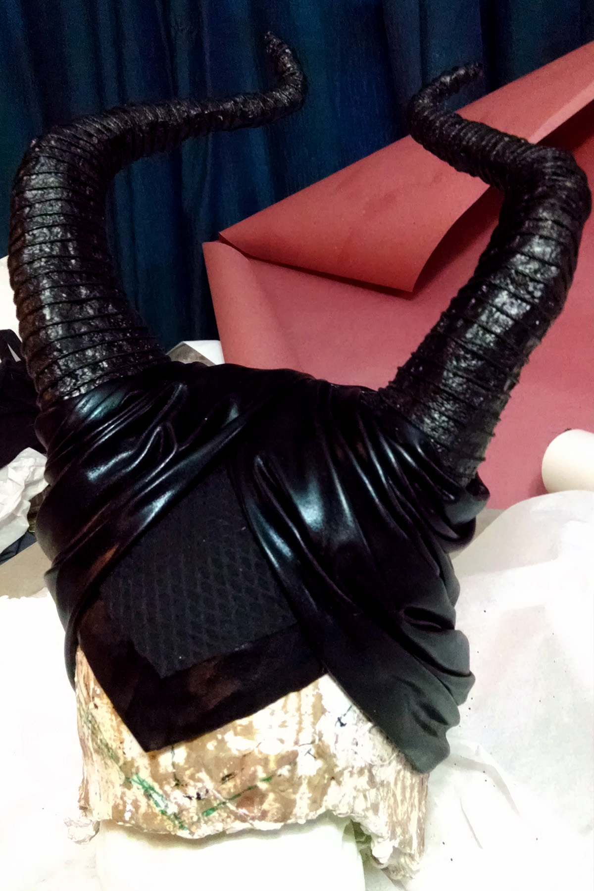 Maleficent's headpiece and horns, completed and resting on a head form.