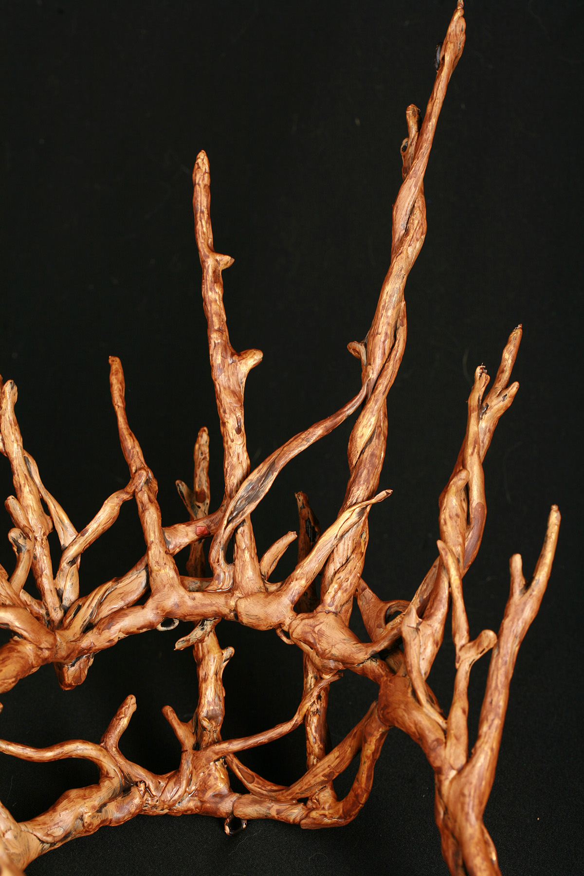 A plastic replica of a Thranduil crown - from The Hobbit -painted to look realistically like wooden twigs.