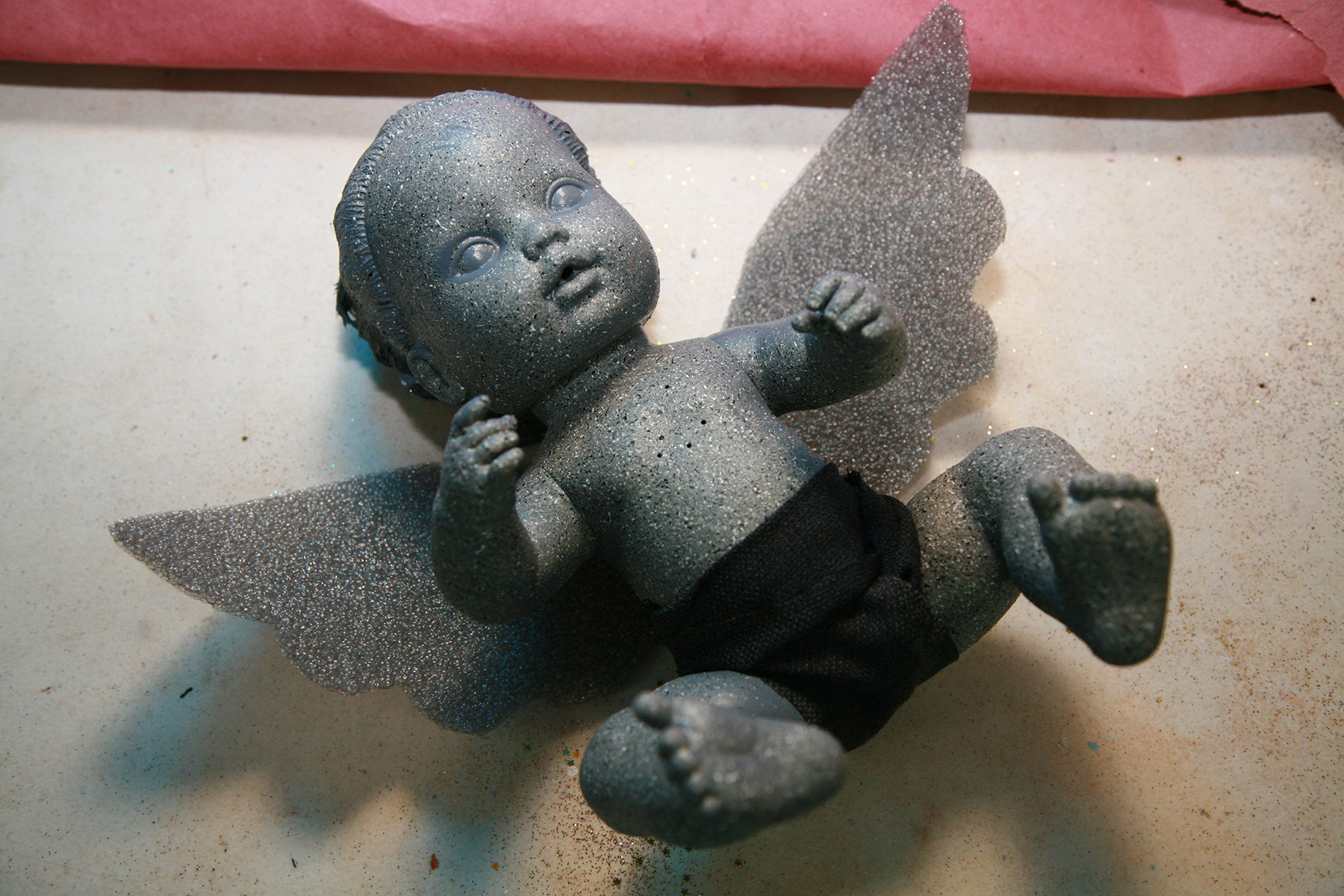 A baby weeping angel doll.