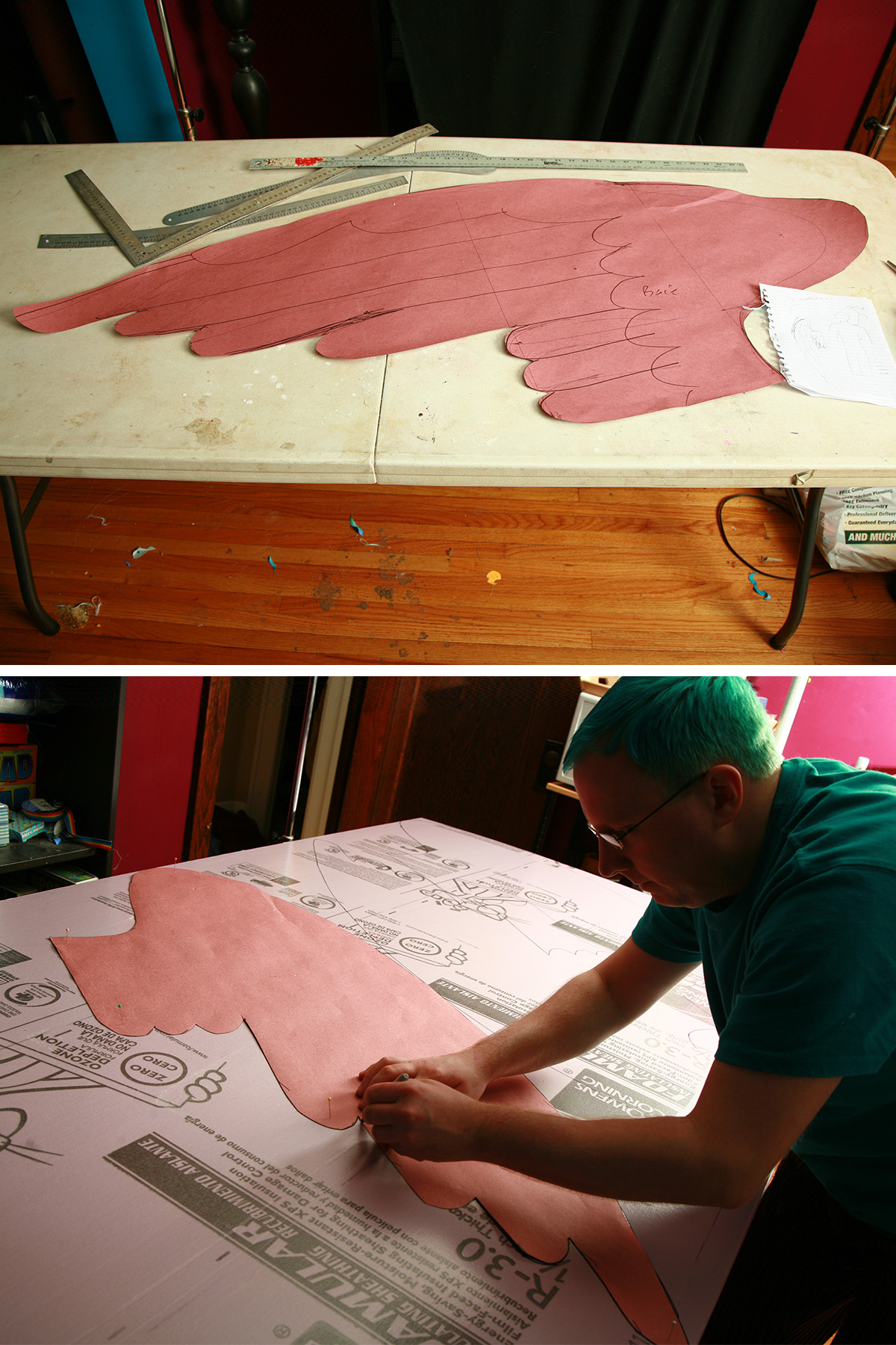 A large wing drawn on heavy pink paper, and a man using it as a pattern to cut pink foam insulation.